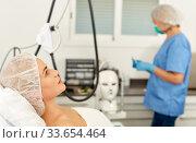 Young woman waiting for cosmetic procedure in clinic of esthetic cosmetology. Стоковое фото, фотограф Яков Филимонов / Фотобанк Лори