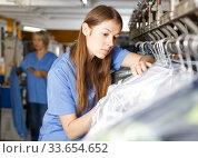 Купить «Two female dry-cleaning salon employees», фото № 33654652, снято 22 января 2019 г. (c) Яков Филимонов / Фотобанк Лори