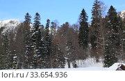Купить «Beautiful mountains covered with snow. Sunny day and blue sky on a frosty day», видеоролик № 33654936, снято 5 марта 2019 г. (c) Олег Хархан / Фотобанк Лори