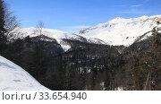 Купить «Beautiful mountains covered with snow. Sunny day and blue sky on a frosty day», видеоролик № 33654940, снято 5 марта 2019 г. (c) Олег Хархан / Фотобанк Лори