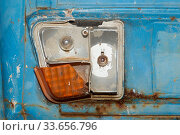 Close-up of busted taillight on rear end of old abandoned and rusted car. Стоковое фото, фотограф Zoonar.com/Micha Klootwijk / age Fotostock / Фотобанк Лори