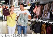 Купить «Couple of customers choosing backpack in showroom», фото № 33659584, снято 7 октября 2019 г. (c) Яков Филимонов / Фотобанк Лори