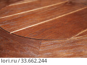 Купить «Vintage round table made of brown wooden plank», фото № 33662244, снято 8 марта 2020 г. (c) EugeneSergeev / Фотобанк Лори