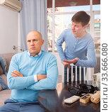 Unhappy man turned away from his son. Стоковое фото, фотограф Яков Филимонов / Фотобанк Лори