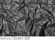 Close-up detail black color background from sheet of crumpled carton, abstract texture wrinkled cardboard material pattern background. Стоковое фото, фотограф А. А. Пирагис / Фотобанк Лори