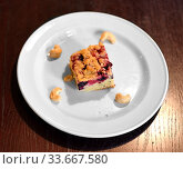 Piece of traditional Finnish blueberry pie on plate. Стоковое фото, фотограф Валерия Попова / Фотобанк Лори