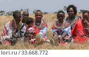 MASAI MARA, KENYA- SEPTEMBER, 26, 2016: a group maasai women in traditional dress at koiyaki guiding school graduation day in kenya. Стоковое фото, фотограф Zoonar.com/Christopher Bellette / age Fotostock / Фотобанк Лори