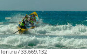 ALEXANDRA HEADLAND, QUEENSLAND, AUSTRALIA- APRIL 21, 2016: female surf life savers compete in a surf boat race on the sunshine coast of australia. Стоковое фото, фотограф Zoonar.com/Christopher Bellette / age Fotostock / Фотобанк Лори
