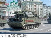 Купить «Российская пусковая установка 9К332МЭ зенитного ракетного нового комплекса «Тор-М2» SA-15 Gauntlet едет после парада в честь Дня Победы по Новому Арбату в Москве», фото № 33672204, снято 9 мая 2018 г. (c) Малышев Андрей / Фотобанк Лори