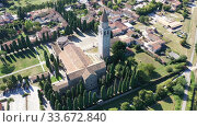 Купить «Scenic aerial view of small Italian city of Aquileia and ancient Patriarchal Basilica di Santa Maria Assunta in sunny summer day», видеоролик № 33672840, снято 4 сентября 2019 г. (c) Яков Филимонов / Фотобанк Лори
