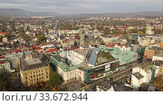 Купить «Aerial view of Liberec cityscape with buildings and streets, Czech Republic», видеоролик № 33672944, снято 19 октября 2019 г. (c) Яков Филимонов / Фотобанк Лори