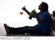 Купить «Young man suffering from alcoholism», фото № 33677216, снято 10 сентября 2019 г. (c) Elnur / Фотобанк Лори