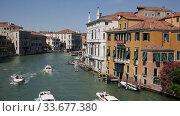Купить «Picturesque Venice cityscape with Grand canal, moored boats, gondolas and ancients colorful buildings on banks of canal», видеоролик № 33677380, снято 5 сентября 2019 г. (c) Яков Филимонов / Фотобанк Лори