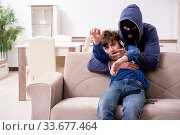 Child abduction concept with young boy. Стоковое фото, фотограф Elnur / Фотобанк Лори