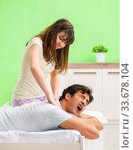 Купить «Woman doing massage to her husband in bedroom», фото № 33678104, снято 25 июня 2018 г. (c) Elnur / Фотобанк Лори