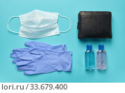 Medical mask, gloves, an antiseptic and a wallet are a set of necessary things for going to the supermarket. Стоковое фото, фотограф Олег Белов / Фотобанк Лори