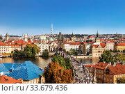 Top view of Prague, the Vltava river and the Charles bridge with crowds of tourists. Czech Republic (2014 год). Стоковое фото, фотограф Наталья Волкова / Фотобанк Лори