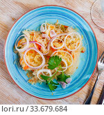 Купить «Sauerkraut with carrots and onion in plate on the table», фото № 33679684, снято 8 июля 2020 г. (c) Яков Филимонов / Фотобанк Лори