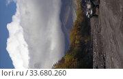 Купить «Vertical footage sport utility vehicle Lexus, Isuzu and Toyota Land Cruiser driving on mountain road on volcanic dry river in direction travel destinations», видеоролик № 33680260, снято 23 сентября 2018 г. (c) А. А. Пирагис / Фотобанк Лори