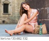 Купить «young girl in romantic dress sitting in town», фото № 33682132, снято 26 августа 2017 г. (c) Яков Филимонов / Фотобанк Лори