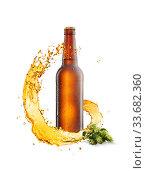 Купить «Cold bottle with water drops, spiral splash and branch of hop.», фото № 33682360, снято 7 февраля 2012 г. (c) Ярослав Данильченко / Фотобанк Лори