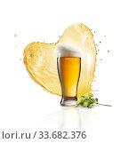 Купить «Glass of fresh beer with splash in the shape of heart and hop banch.», фото № 33682376, снято 16 января 2015 г. (c) Ярослав Данильченко / Фотобанк Лори