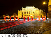 Coronavirus in Prague, Czech Republic.The building of Rudolfiunum concert halls on Jan Palach Square. Covid-19 sign on a blurred background. Concept of COVID pandemic and travel in Europe. (2019 год). Стоковое фото, фотограф Владимир Журавлев / Фотобанк Лори