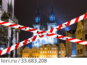 Coronavirus in Prague, Czech Republic. The gothic Church of Mother of God in front of Tyn in Old Town Square. Covid-19 sign on a blurred background. Concept of COVID pandemic and travel in Europe. (2019 год). Стоковое фото, фотограф Владимир Журавлев / Фотобанк Лори