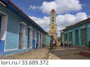 Купить «Sightseeing by horsecart in UNESCO World Heritage Trinidad, Cuba.», фото № 33689372, снято 19 марта 2020 г. (c) age Fotostock / Фотобанк Лори
