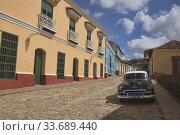 Купить «Vintage Chevy in UNESCO World Heritage Trinidad, Cuba.», фото № 33689440, снято 19 марта 2020 г. (c) age Fotostock / Фотобанк Лори