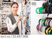 Woman choosing buttons in needlecraft store. Стоковое фото, фотограф Яков Филимонов / Фотобанк Лори