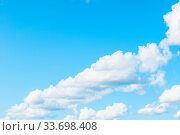 Купить «Blue sky background. Picturesque colorful clouds lit by sunlight. Vast sky landscape panoramic view», фото № 33698408, снято 16 августа 2019 г. (c) Зезелина Марина / Фотобанк Лори