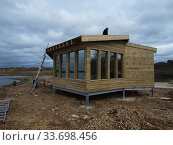 Купить «Construction of the new Tern Hide beside Ibsley Water, Blashford Lakes Nature Reserve. Hampshire and Isle of Wight Wildlife Trust Reserve, Ellingham, near Ringwood, Hampshire, England, UK, March 2019», фото № 33698456, снято 29 мая 2020 г. (c) Nature Picture Library / Фотобанк Лори