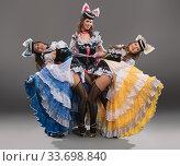 Купить «Showgirls in glamour pin-up dresses view», фото № 33698840, снято 12 апреля 2020 г. (c) Гурьянов Андрей / Фотобанк Лори