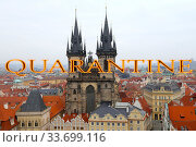Coronavirus in Prague, Czech Republic. The gothic Church of Mother of God in front of Tyn. Quarantine sign. Concept of COVID pandemic and travel in Europe. (2019 год). Стоковое фото, фотограф Владимир Журавлев / Фотобанк Лори