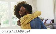 Купить «Happy couple hugging each other », видеоролик № 33699524, снято 19 февраля 2020 г. (c) Wavebreak Media / Фотобанк Лори