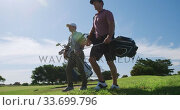 Купить «Caucasian male golfers standing on a golf course on a sunny day», видеоролик № 33699796, снято 4 ноября 2019 г. (c) Wavebreak Media / Фотобанк Лори