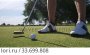 Купить «Golf player hitting the ball with his club», видеоролик № 33699808, снято 4 ноября 2019 г. (c) Wavebreak Media / Фотобанк Лори