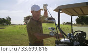 Caucasian male golfer replacing a club into a golf bag. Стоковое видео, агентство Wavebreak Media / Фотобанк Лори