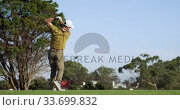Купить «Golf player hitting the ball with his club», видеоролик № 33699832, снято 4 ноября 2019 г. (c) Wavebreak Media / Фотобанк Лори