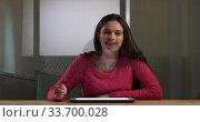 Купить «Caucasian woman using a digital tablet», видеоролик № 33700028, снято 23 июля 2019 г. (c) Wavebreak Media / Фотобанк Лори