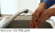 Купить «Caucasian woman washing her hands with soap at home», видеоролик № 33700224, снято 9 апреля 2020 г. (c) Wavebreak Media / Фотобанк Лори