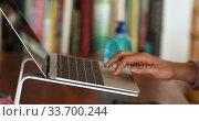 Купить «Caucasian woman using a laptop at home», видеоролик № 33700244, снято 9 апреля 2020 г. (c) Wavebreak Media / Фотобанк Лори
