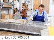 Купить «Male and female working on glass washing machine», фото № 33705364, снято 10 сентября 2018 г. (c) Яков Филимонов / Фотобанк Лори