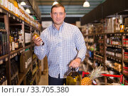 Купить «Customer buying oil in supermarket», фото № 33705380, снято 9 октября 2019 г. (c) Яков Филимонов / Фотобанк Лори