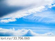 Купить «Dramatic blue sky background. Picturesque colorful clouds lit by sunlight. Vast sky landscape panoramic scene», фото № 33706060, снято 28 апреля 2018 г. (c) Зезелина Марина / Фотобанк Лори