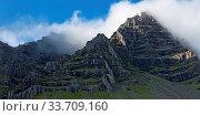 Купить «Wolken vor blauem Himmel am Berg Mosfell, Ostisland, Island, Europa», фото № 33709160, снято 28 мая 2020 г. (c) age Fotostock / Фотобанк Лори