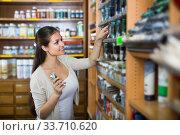 Купить «woman choosing paint color in tube», фото № 33710620, снято 25 мая 2020 г. (c) Яков Филимонов / Фотобанк Лори