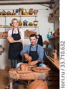 Купить «two potters working with ceramics in atelier», фото № 33710632, снято 3 июня 2020 г. (c) Яков Филимонов / Фотобанк Лори