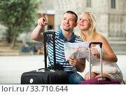 Купить «Couple searching direction using map», фото № 33710644, снято 25 мая 2020 г. (c) Яков Филимонов / Фотобанк Лори